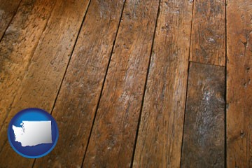 a distressed wood floor - with Washington icon