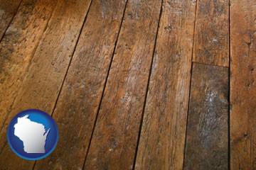a distressed wood floor - with Wisconsin icon