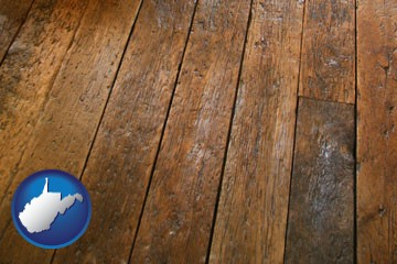 a distressed wood floor - with West Virginia icon