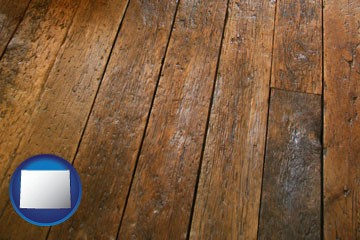 a distressed wood floor - with Wyoming icon