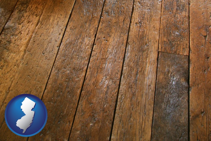 a distressed wood floor - with New Jersey icon - Floors & Flooring Retailers In New Jersey