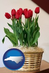 north-carolina map icon and a gift basket with red tulips