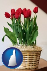 new-hampshire map icon and a gift basket with red tulips