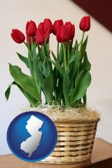 new-jersey map icon and a gift basket with red tulips