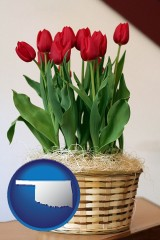 oklahoma map icon and a gift basket with red tulips