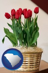 south-carolina map icon and a gift basket with red tulips