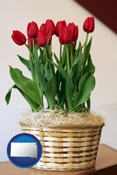 a gift basket with red tulips - with South Dakota icon