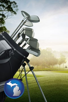 golf clubs on a golf course - with Michigan icon