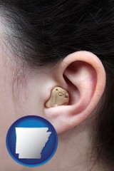 arkansas map icon and a woman wearing a hearing aid in her left ear