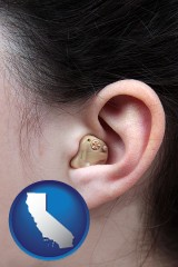 california map icon and a woman wearing a hearing aid in her left ear