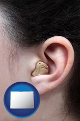 colorado a woman wearing a hearing aid in her left ear