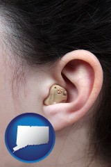 connecticut map icon and a woman wearing a hearing aid in her left ear