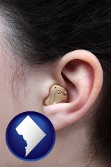 washington-dc map icon and a woman wearing a hearing aid in her left ear