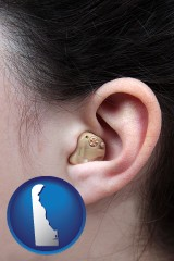 delaware map icon and a woman wearing a hearing aid in her left ear