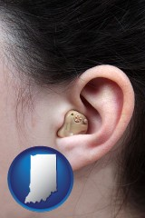 indiana map icon and a woman wearing a hearing aid in her left ear