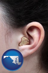 maryland a woman wearing a hearing aid in her left ear