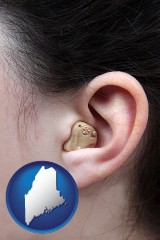 maine map icon and a woman wearing a hearing aid in her left ear