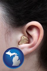 michigan a woman wearing a hearing aid in her left ear