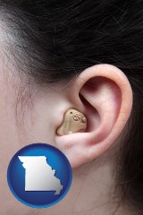 missouri map icon and a woman wearing a hearing aid in her left ear