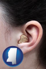 mississippi map icon and a woman wearing a hearing aid in her left ear