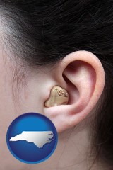 north-carolina a woman wearing a hearing aid in her left ear