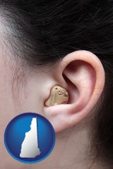 new-hampshire map icon and a woman wearing a hearing aid in her left ear