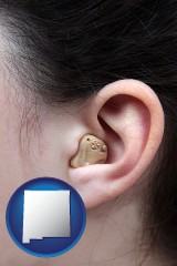 new-mexico map icon and a woman wearing a hearing aid in her left ear