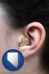 nevada map icon and a woman wearing a hearing aid in her left ear