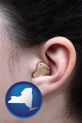 new-york map icon and a woman wearing a hearing aid in her left ear