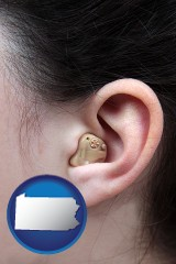 pennsylvania map icon and a woman wearing a hearing aid in her left ear