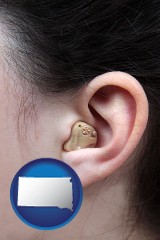 south-dakota a woman wearing a hearing aid in her left ear
