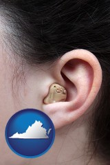 virginia map icon and a woman wearing a hearing aid in her left ear