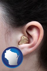 wisconsin map icon and a woman wearing a hearing aid in her left ear