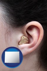 wyoming a woman wearing a hearing aid in her left ear