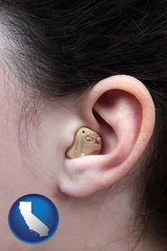 a woman wearing a hearing aid in her left ear - with California icon