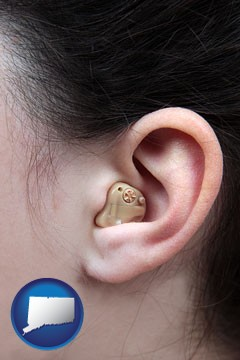 a woman wearing a hearing aid in her left ear - with Connecticut icon