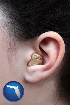 a woman wearing a hearing aid in her left ear - with Florida icon