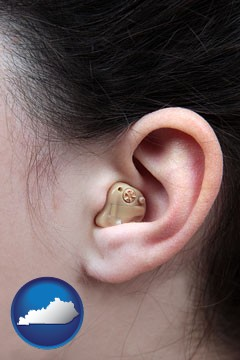 a woman wearing a hearing aid in her left ear - with Kentucky icon