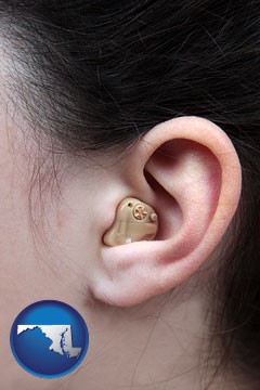 a woman wearing a hearing aid in her left ear - with Maryland icon