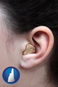a woman wearing a hearing aid in her left ear - with New Hampshire icon
