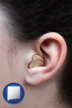 a woman wearing a hearing aid in her left ear - with New Mexico icon