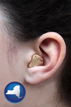 a woman wearing a hearing aid in her left ear - with New York icon