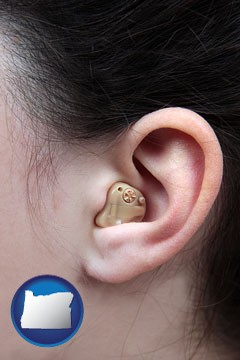a woman wearing a hearing aid in her left ear - with Oregon icon