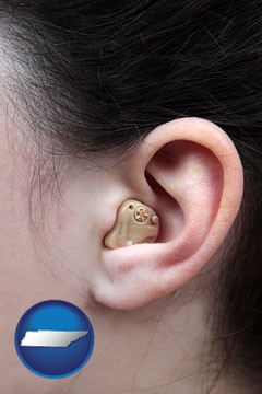 a woman wearing a hearing aid in her left ear - with Tennessee icon