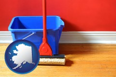 alaska map icon and a bucket and mop on a hardwood floor
