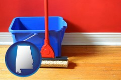 alabama map icon and a bucket and mop on a hardwood floor