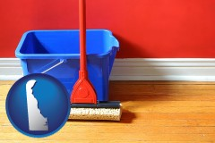 delaware a bucket and mop on a hardwood floor