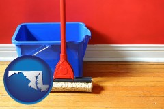 maryland map icon and a bucket and mop on a hardwood floor