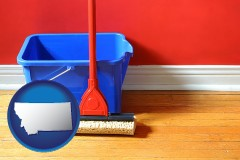 montana map icon and a bucket and mop on a hardwood floor