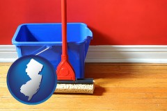 new-jersey map icon and a bucket and mop on a hardwood floor
